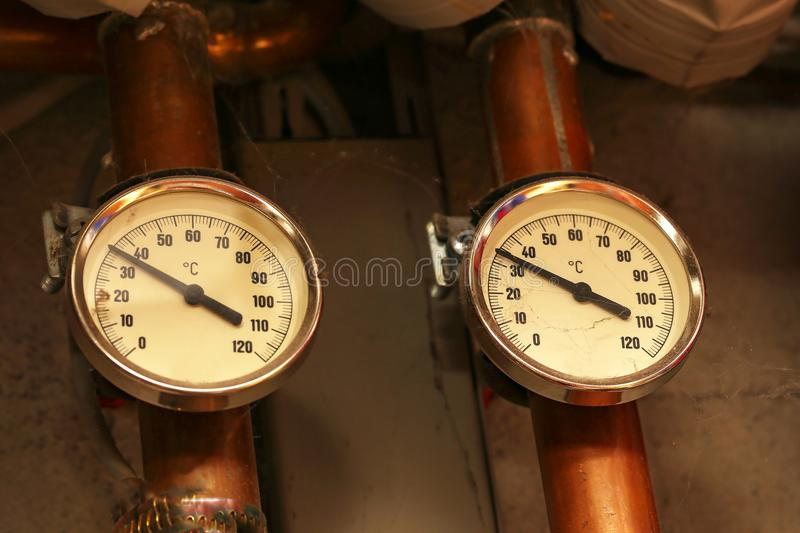 Heating system in the house. / Devices measuring the temperature of water in pipes royalty free stock photography