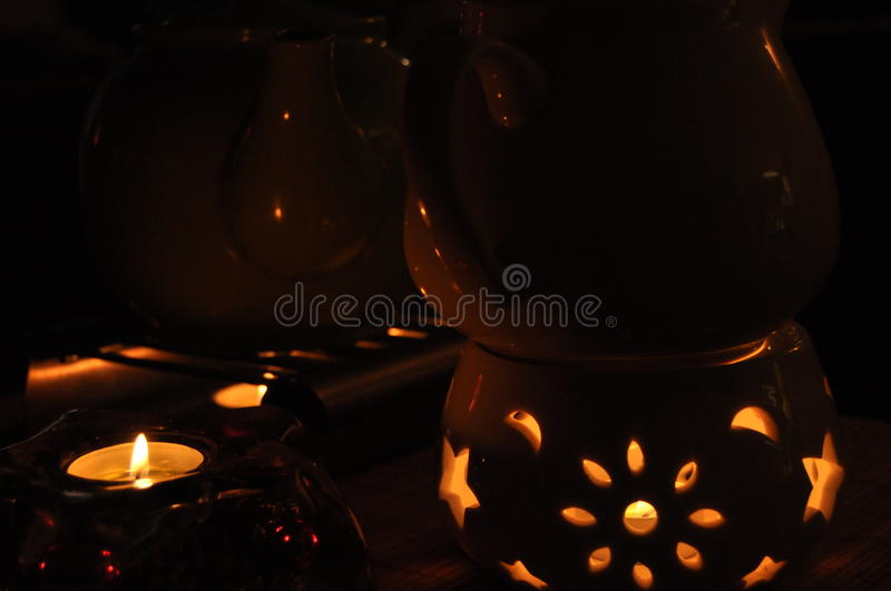 Heating tea kettle, teapot standing over the fire. royalty free stock photography