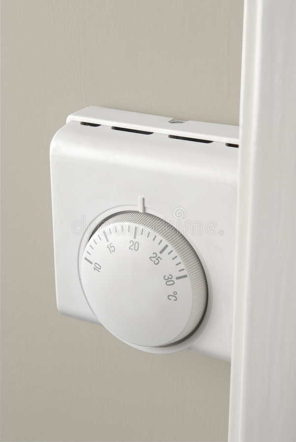 Heating thermostat. Heating temperature thermostat fixed on the wall royalty free stock images
