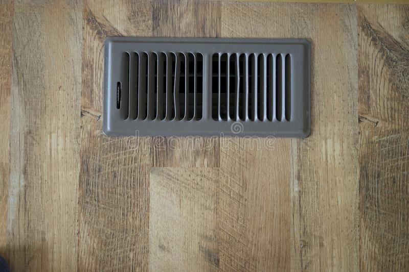 Heating Vent On Floor. Furnace Heat comes from the vent on floor stock photography