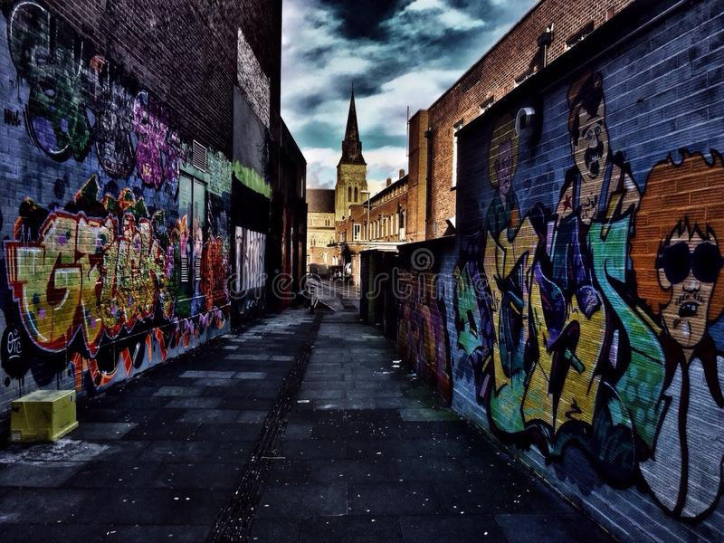 Heaven or Hell. Streetart path graffiti paint spraypaint church clouds drama street streetphotography wall royalty free stock images