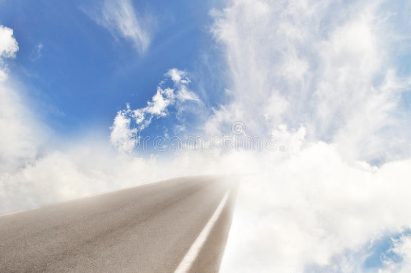 Heaven road turn into clouds stock images