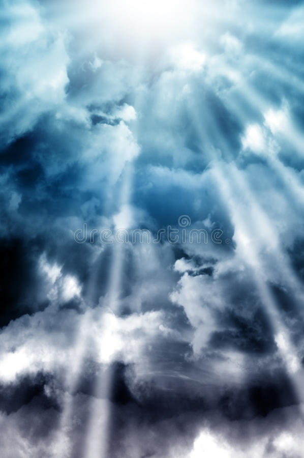 Heaven skies. Majestic clouds and rays of light in the blue skies stock photo