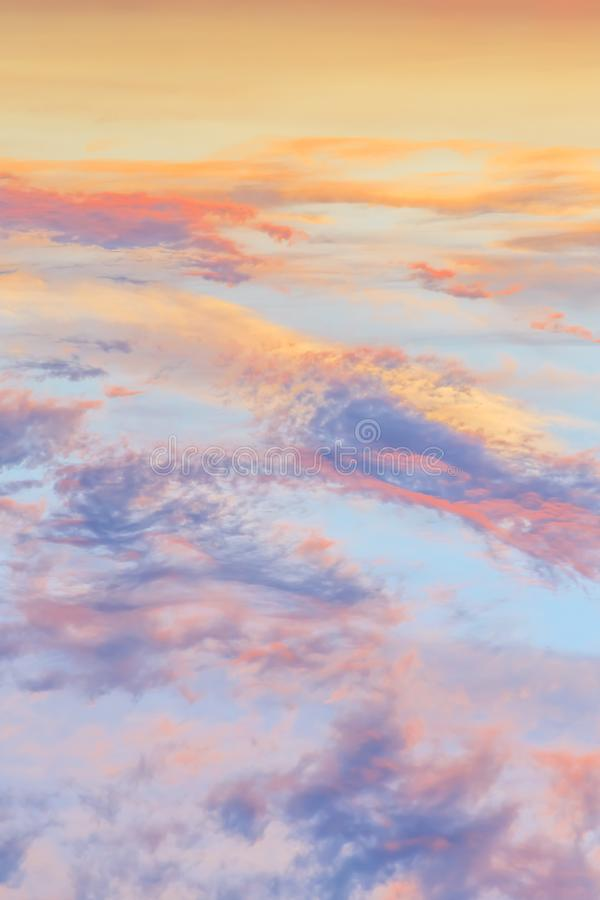 Heavenly abstract summer gentle vertical background. Beautiful picturesque bright majestic dramatic evening morning sky at sunset stock images