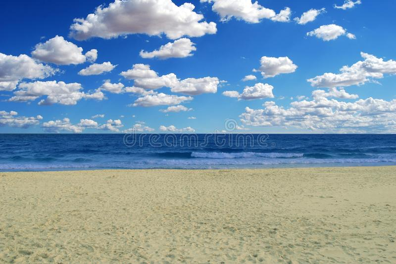 A heavenly beach under a beautiful blue sky with a few clouds. This is picture royalty free stock photo