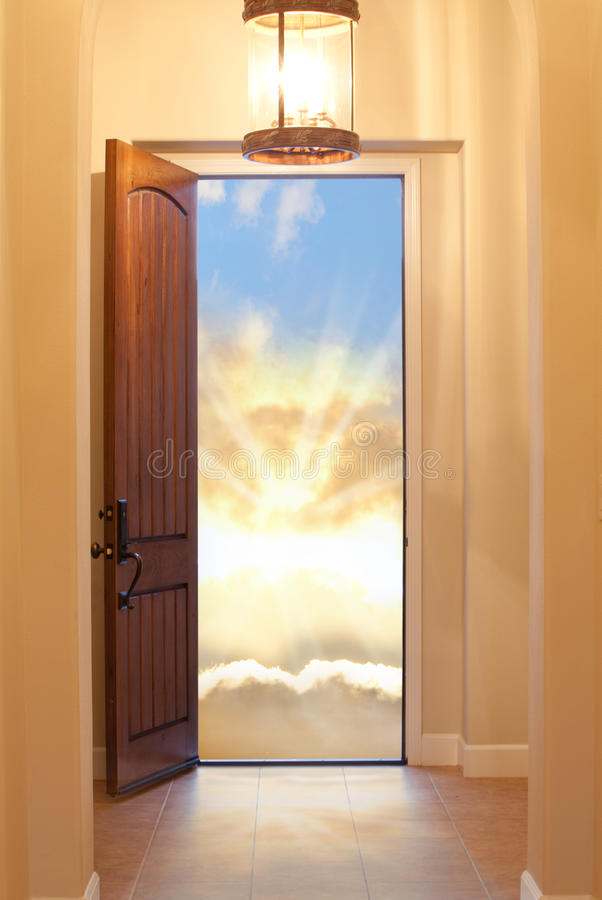 Heavenly Door. Hallway with lit chandelier leading to an open door representing the entrance to the heavens, a climax, success or freedom royalty free stock photos