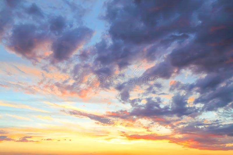 Heavenly summer background. Beautiful bright majestic dramatic evening sky at sunset or sunrise orange and blue with rays. The sun stock photo