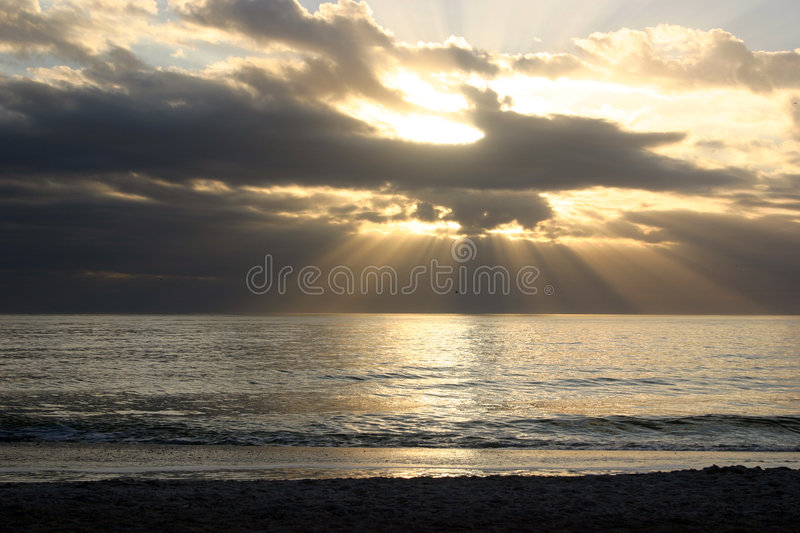 Heavens breaking over water stock images
