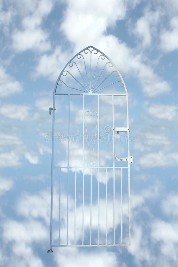 Heavens gate. A white wrought iron gate against a cloudy background (with clipping path) depicting heaven stock photography