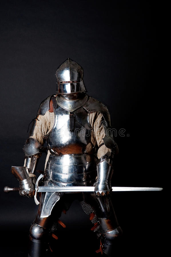 Heavy Armoured Man Holding His Sword Stock Image