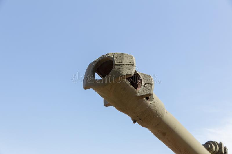 Heavy artillery barrel. Barrel of heavy artillery against the blue sky. Concept of military conflict royalty free stock photography