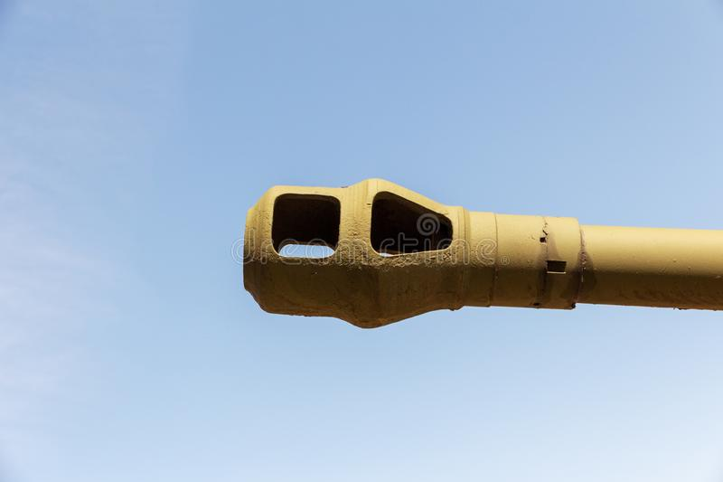 Heavy artillery barrel. Barrel of heavy artillery against the blue sky. Concept of military conflict royalty free stock photo