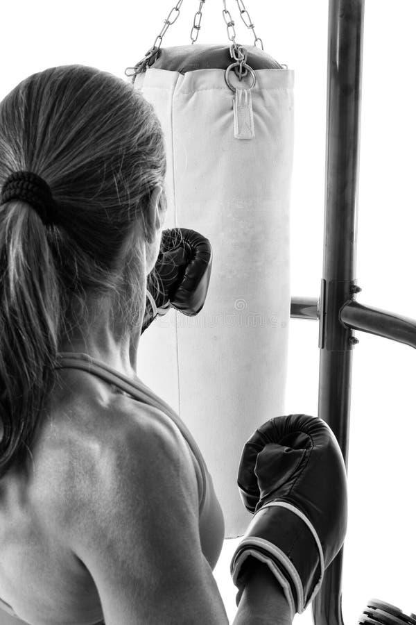 Heavy Bag Exercise. Studio shot over white stock photo