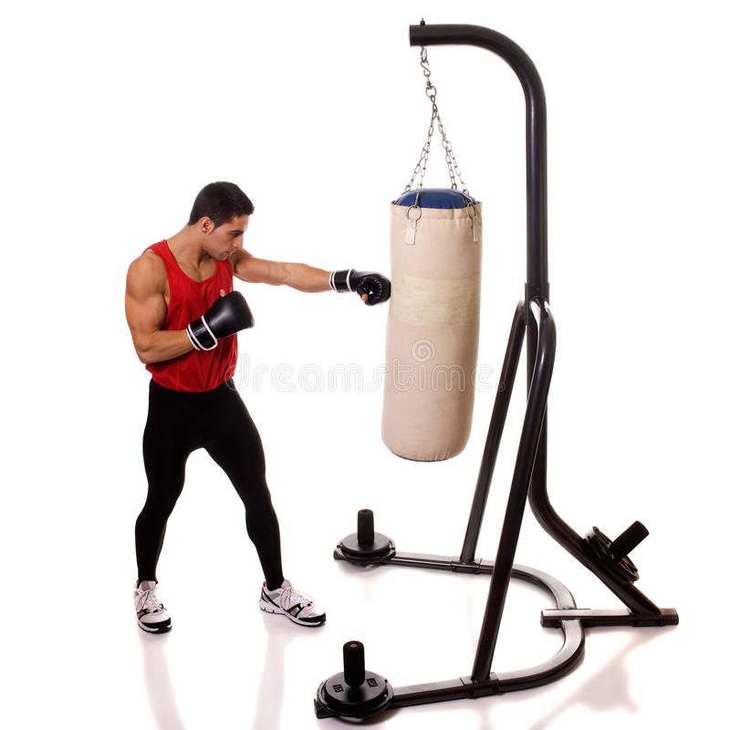 Heavy Bag Workout. Boxing workout with heavy bag. Studio shot over white royalty free stock photography