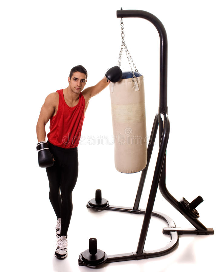 Heavy Bag Workout. Boxing workout with heavy bag. Studio shot over white stock photography