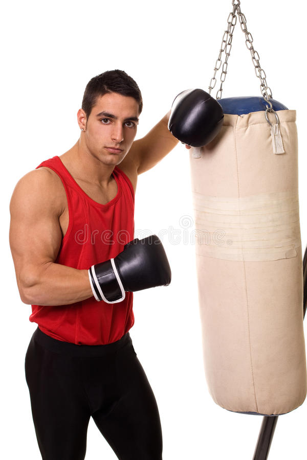 Heavy Bag Workout. Boxing workout with heavy bag. Studio shot over white royalty free stock photo