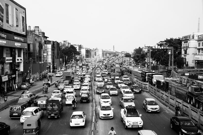 Heavy car traffic in the city center of Delhi, India. DELHI, INDIA - JULY 5, 2016: Heavy car traffic in the city center of Delhi, India. Buses and construction royalty free stock photos