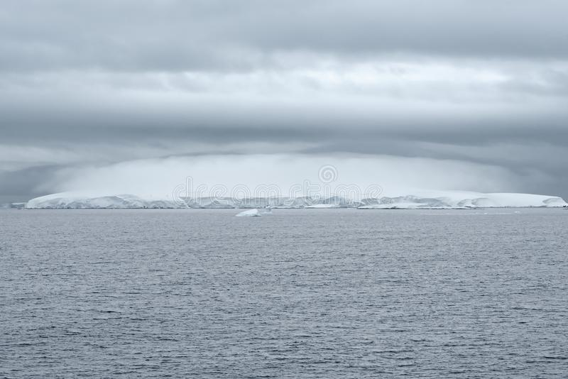 Heavy Cloud Formation Above An Iceberg, Antarctica royalty free stock image