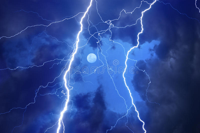 Heavy clouds bringing thunder and lightnings royalty free stock photography
