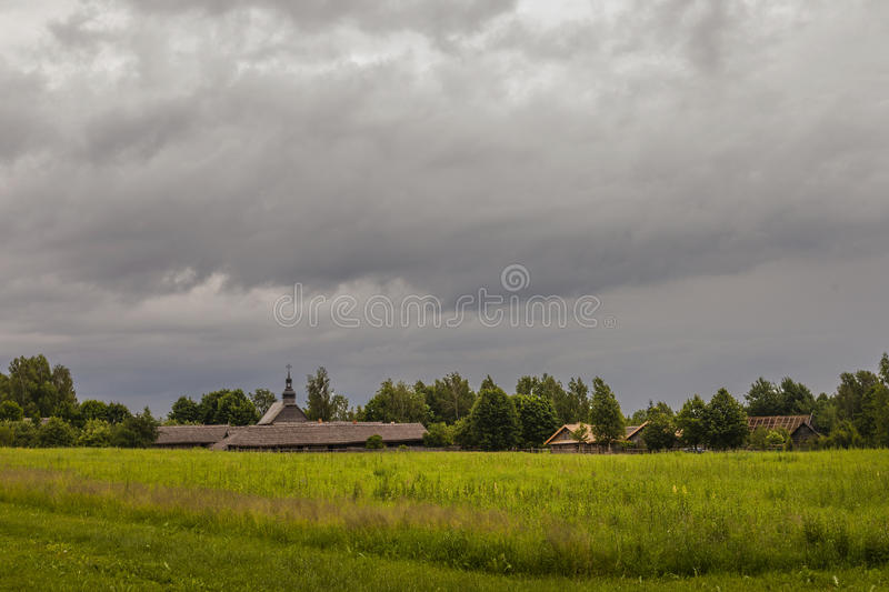 Heavy clouds over a typical village on a windy dayfor print royalty free stock images
