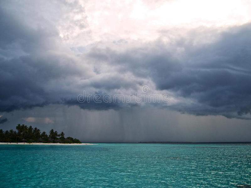 Tropical Island Beach Ambience Sound: Heavy Clouds And Rain Over The Ocean Stock Image