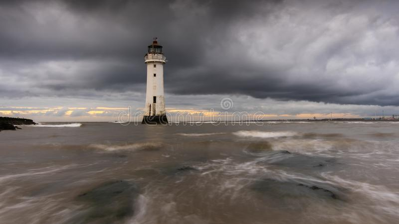 Heavy cloudy lie over New Brighton Lighthouse royalty free stock image