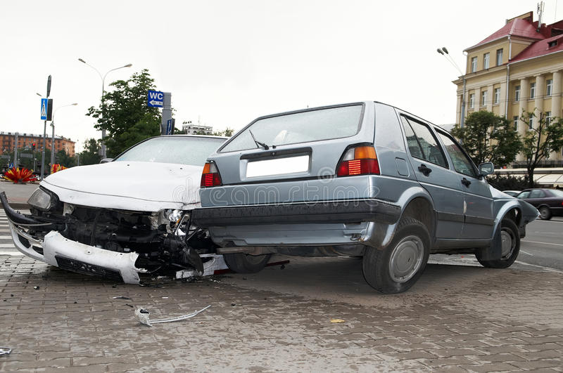 Heavy damage car accident. Road crash accident with extensive damage of car body stock photography