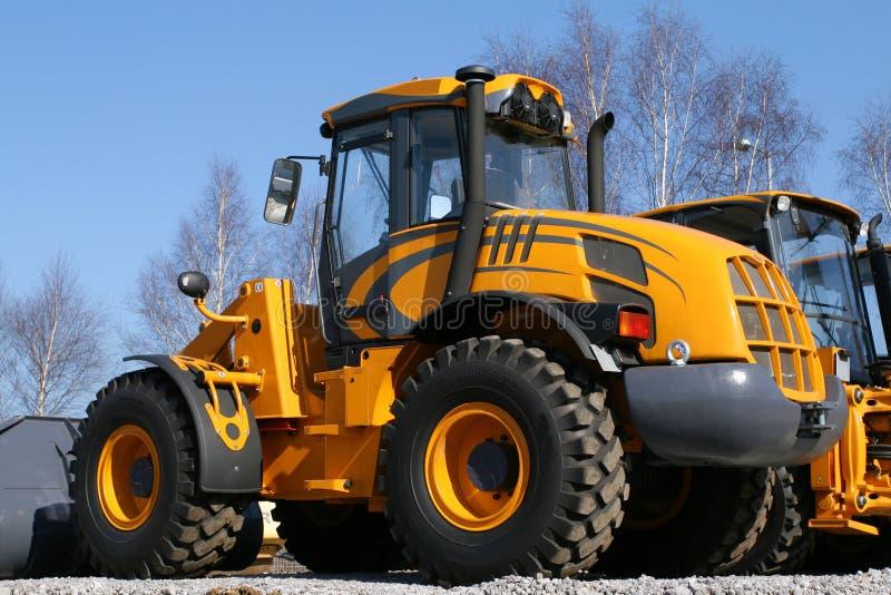 Heavy dozer. New, shiny and modern orange dozer machine. Construction industry machinery stock image