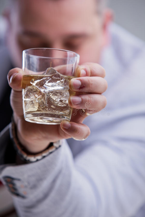 Heavy drinker shows a glass of blame stock images
