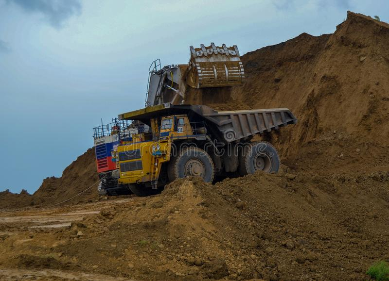 Heavy dump truck at work royalty free stock image