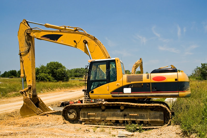 Heavy duty excavator. A view of a large, heavy duty shovel or excavator parked on a construction site royalty free stock photo