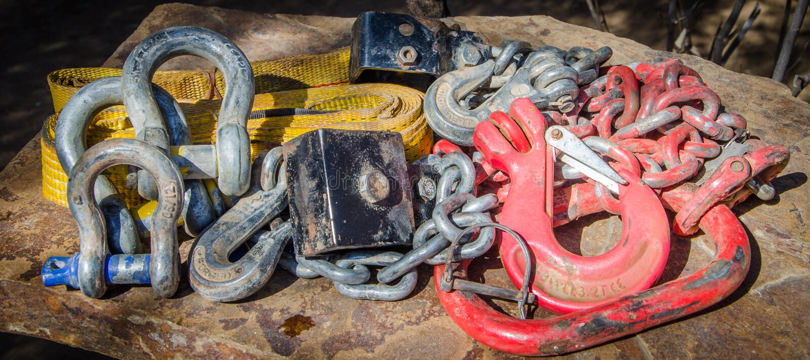 Heavy duty recovery equipment for 4x4 offroad use with chains, shackles and belts outdoors.  royalty free stock photography