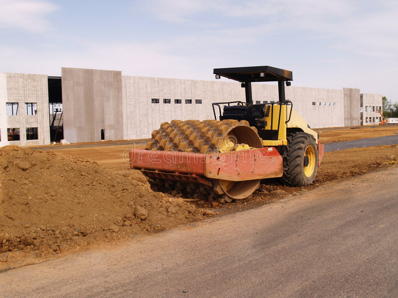 Heavy duty roller by a warehouse stock image