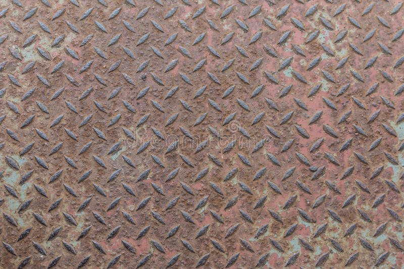 Heavy duty rusty metal with non slip repetitive patten and corroded vintage industrial steel plate structure as a retro grunge ba stock photography