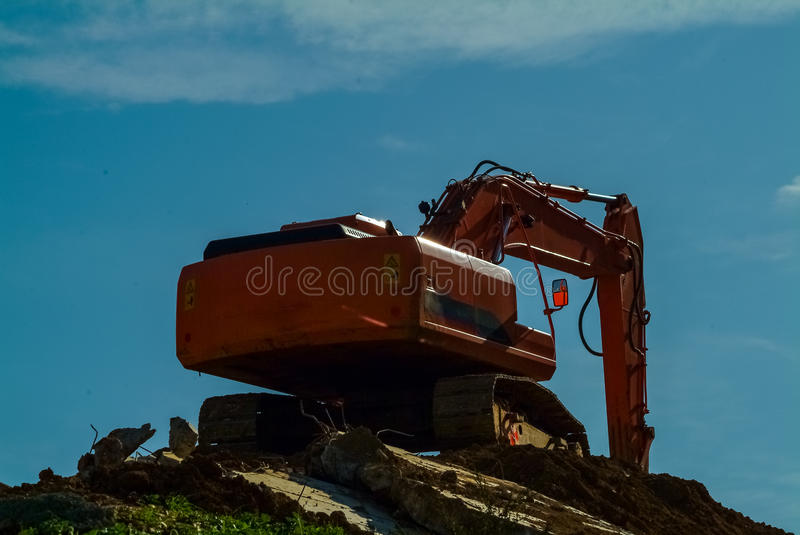 Heavy earth mover, excavator loader machine during earthmoving w. Orks outdoors at construction site stock photography