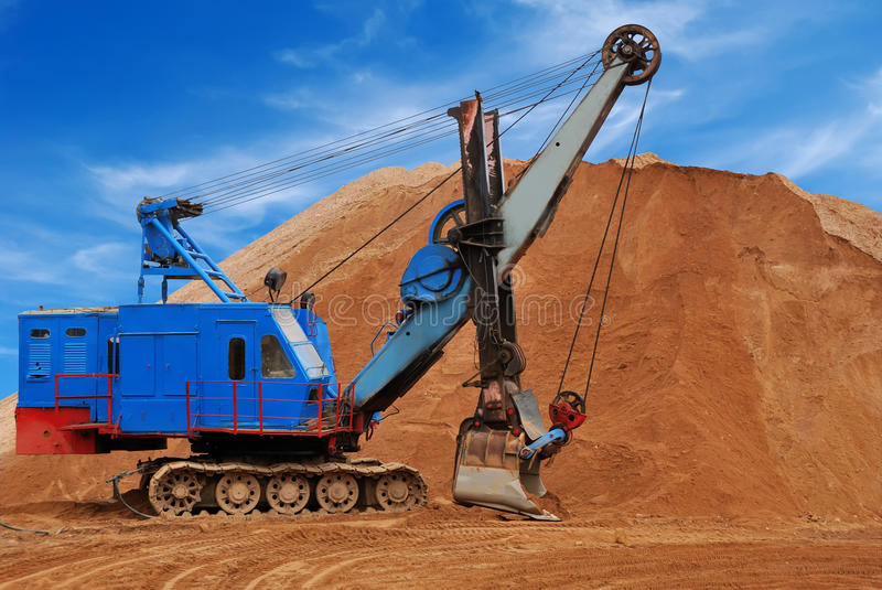 Heavy electric excavator in sandpit royalty free stock images