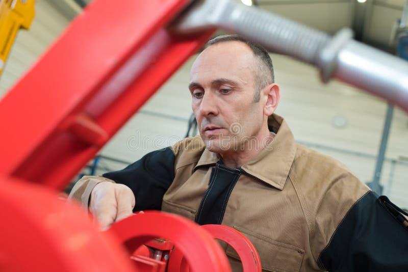 Heavy equipment technician doing work stock image