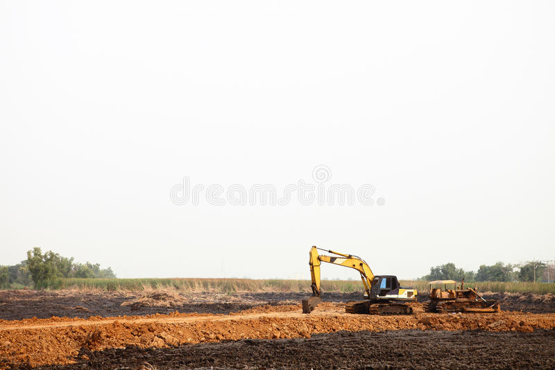Heavy excavating equipment at construction site. stock photos