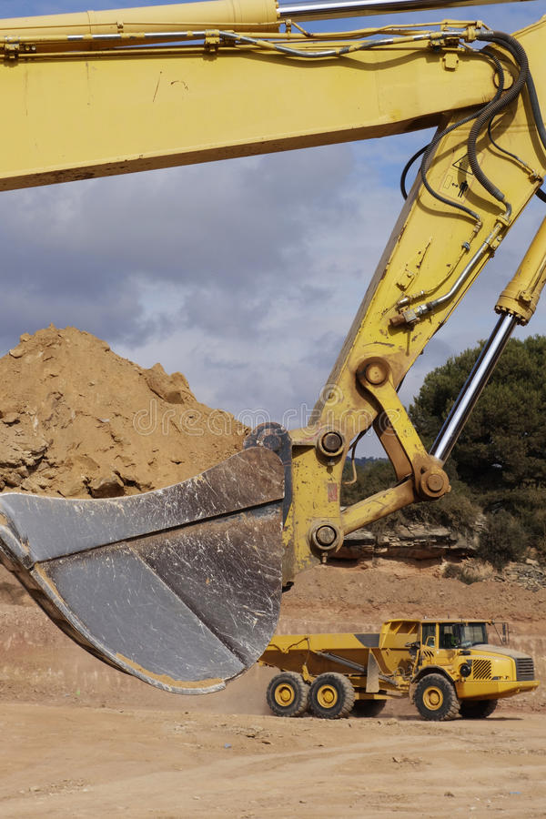 Heavy excavator and truck royalty free stock photo