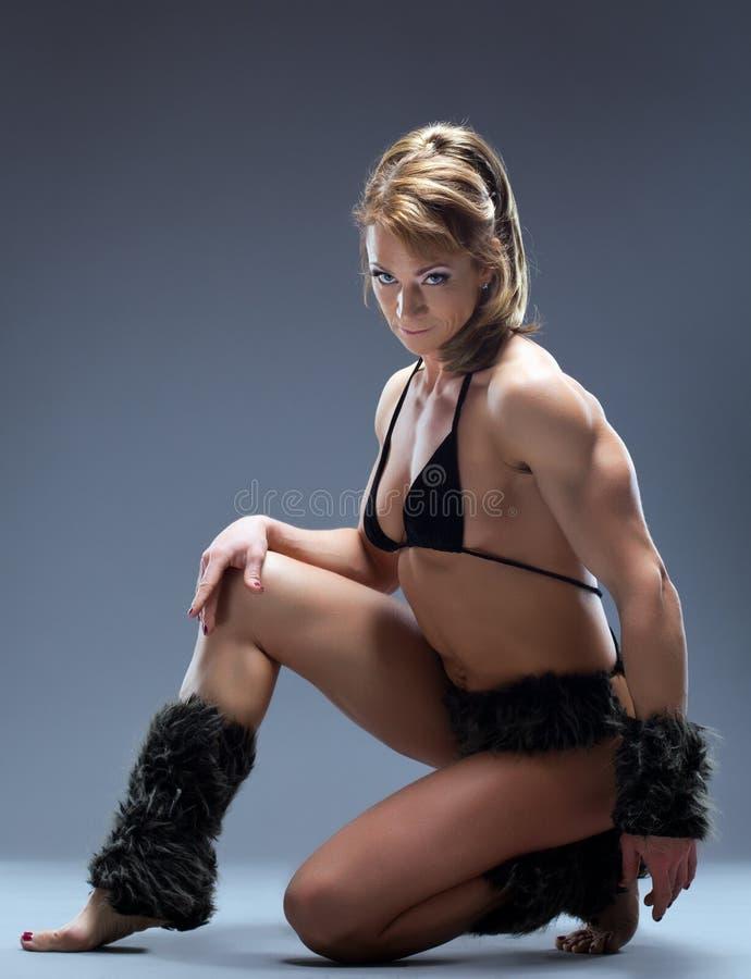 Heavy female body builder in amazon fur costume royalty free stock photos