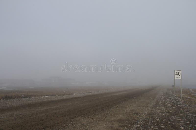 Heavy fog along the coastline of Arviat. Nunavut royalty free stock image