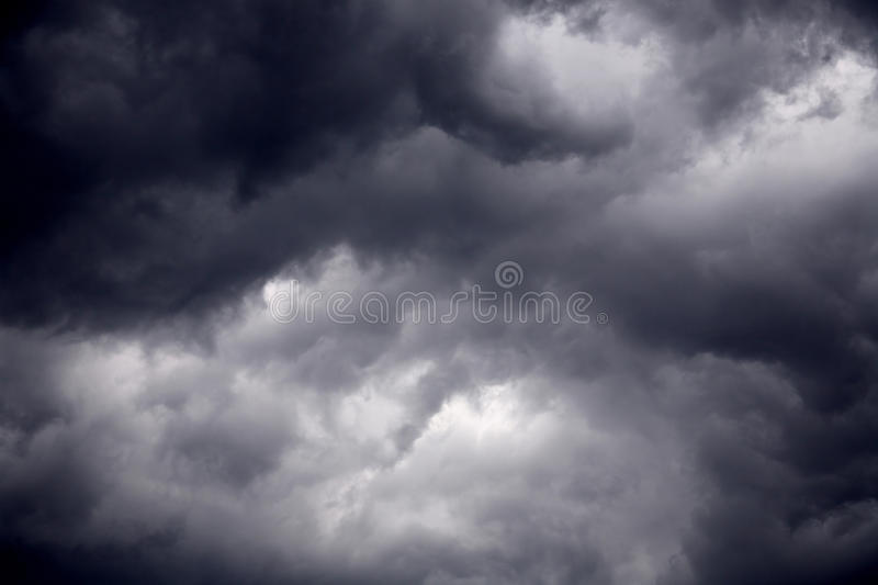 Heavy gale black stormy clouds. The big powerful storm clouds before a thunder-storm royalty free stock photo