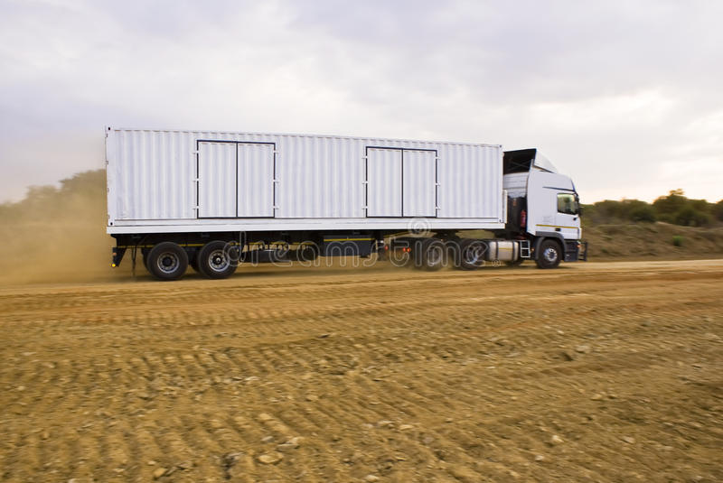 Download Heavy Goods In Transit Via Dirt Roads Stock Photo - Image: 11187922