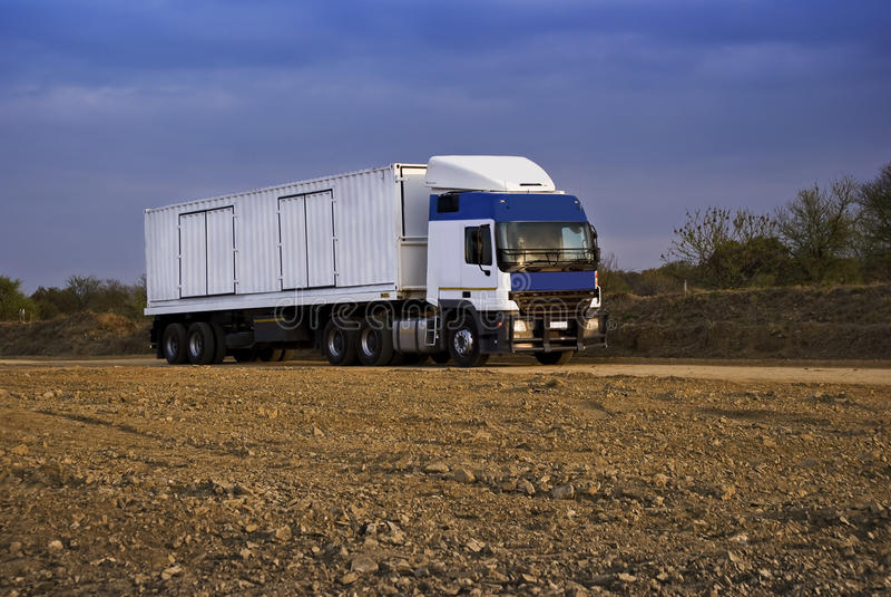 Heavy Goods in Transit via Dirt Roads stock image