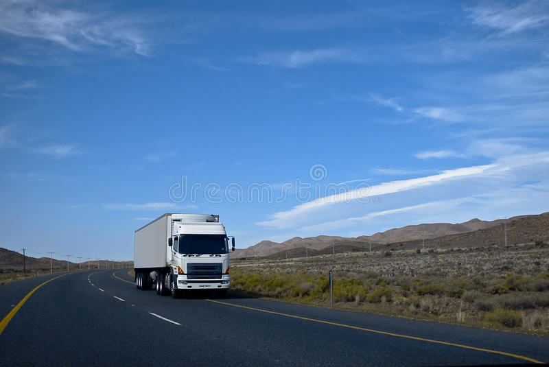 Heavy Goods in Transit via Tarred Roads stock image