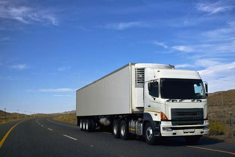 Heavy Goods in Transit via Tarred Roads stock photo