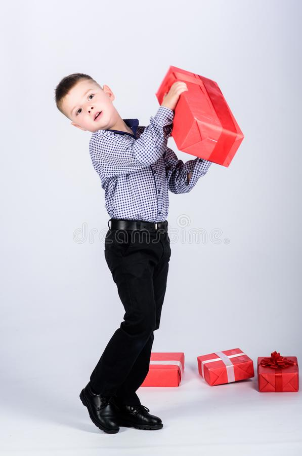 So heavy. happy child with present box. Christmas. shop assistant. Happy childhood. Shopping. Boxing day. New year stock images