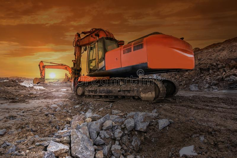 Heavy hydraulic machinery in construction works at dawn stock photo