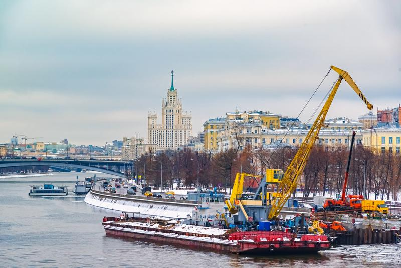Heavy industrial crane based on floating pontoon. Construction of a new pier on the Moscow river. Russia, Moscow - DEC 2018: Heavy industrial crane based on stock image