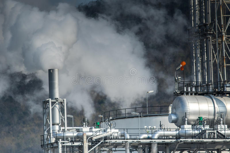 Heavy industrial fog from exhaust tube in petrochemical and power industry estate stock photos